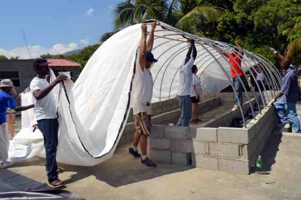 This GP, the first rooftop GP in Haiti, is being covered in shade cloth.
